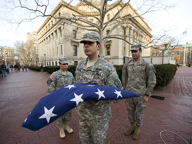 From left: ROTC cadets LeTricia Brown, Jose Robledo, and John McClelland stand after folding the U.S. flag during a flag lowering ceremony at Columbia University.