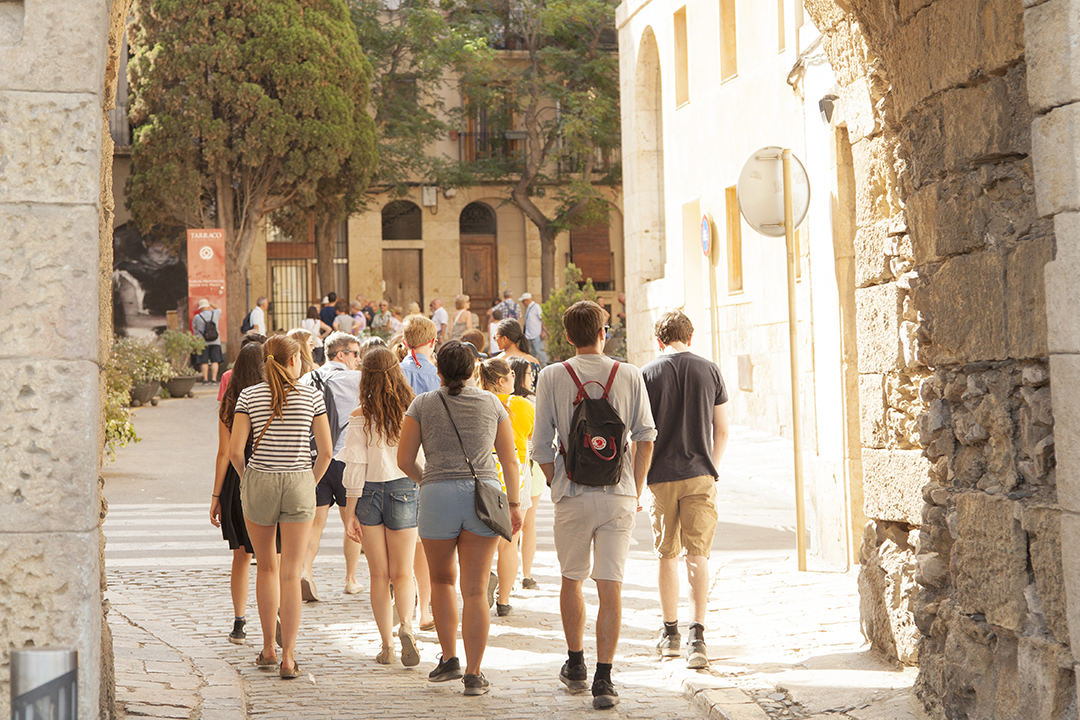 Students walking through historical streets