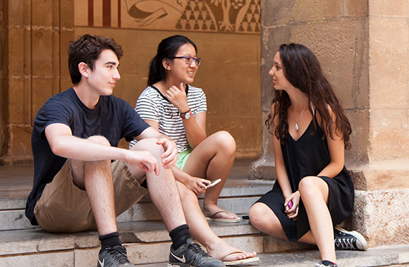 High School Students sitting chatting in Barcelona
